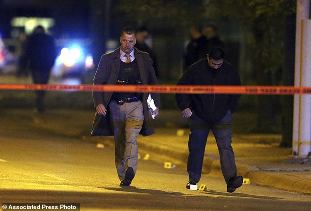 The officers were shot and wounded late Tuesday during an incident in a high crime neighborhood of the city's South Side, a police spokesman said