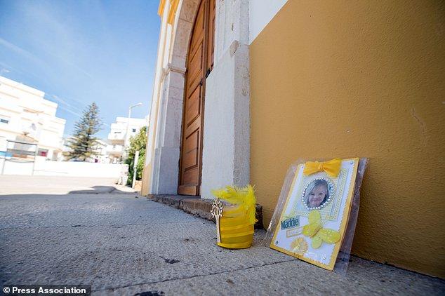 A tribute to Madeleine McCann is left outside the Church of Nossa Senhora da Luz in Praia Da Luz, Portugal (Steve Parsons/PA)