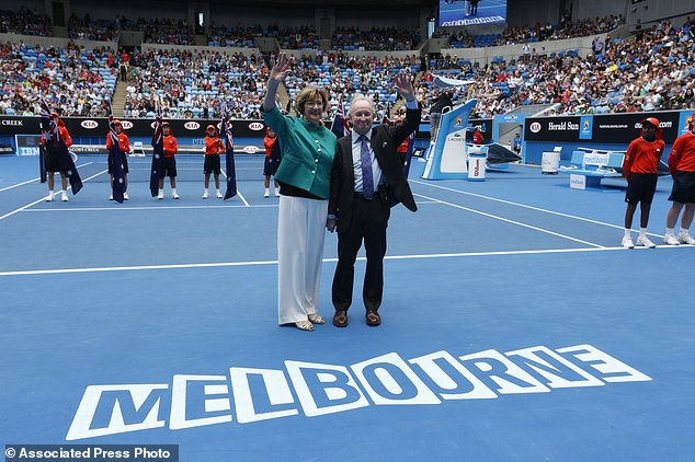 "In this Jan. 26, 2015 photo, Australian tennis greats Margaret Court, left, and Rod Laver wave during the official launch of the remodeled Margaret Court Arena at the Australian Open tennis championship in Melbourne. Former tennis great and now Christian pastor Court says she will stop using Qantas ""where possible"" in protest over the Australian airline's promotion of same-sex marriage. ""I am disappointed that Qantas has become an active promoter for same-sex marriage,"" Perth resident Court said in the letter published Thursday, May 25, 2017, in The West Australian newspaper. (AP Photo/Vincent Thian)"