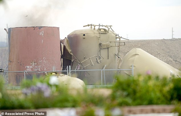 Tanks Are Toppled And Damaged At The Scene Of An Oil Well Explosion Near The Grand View Estates Neighborhood In Weld County On Thursday, May 25, 2017 In Mead, Colo.  The Fatal Oil Tank Battery Fire In Northern Colorado Appears To Be Unrelated To A Nearby Home Explosion Last Month Caused By A Leaky Gas Line. (Lewis Geyer/Daily Camera Via Ap)