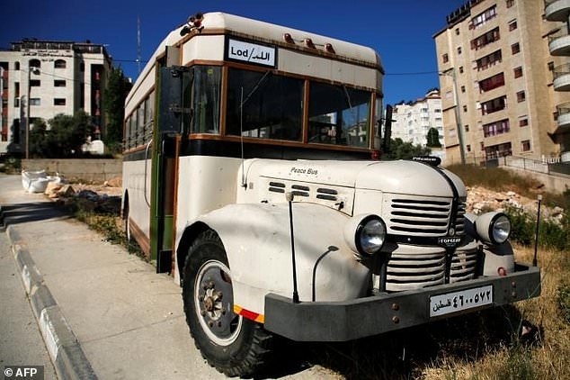 Youths are restoring a bus to preserve the memory of the days before the Six-Day War in 1967 when Palestinian buses ferried passengers around the Middle East