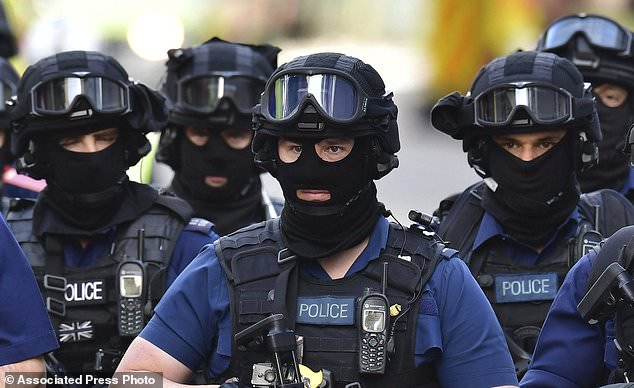 Armed police on St Thomas Street, London, Sunday June 4, 2017, near the scene of Saturday night's terrorist incident on London Bridge and at Borough Market. Several people were killed in the terror attack at the heart of London and dozens injured. Prime Minister Theresa May convened an emergency security cabinet session Sunday to deal with the crisis. (Dominic Lipinski/PA via AP)