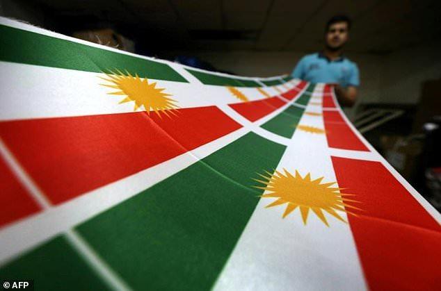 An Iraqi man prints a Kurdistan flag in Arbil, the capital of the autonomous Kurdish region of northern Iraq