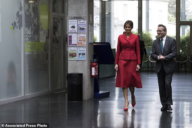 First Lady Melania Trump is welcomed by Martin Hirsch, general director of AP-HP which oversees 39 Paris public teaching hospitals, before visiting the Necker hospital, France's biggest pediatric hospital in Paris, Thursday July 13, 2017. Melania Trump is touring the hospital shortly after her arrival in France with President Donald Trump aboard Air Force One. (AP Photo/Kamil Zihnioglu)