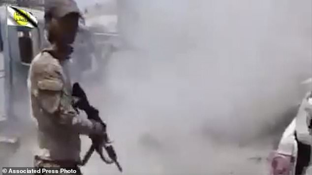 The video shows a man kneeling before he is gunned down by a man in an Iraqi military outfit