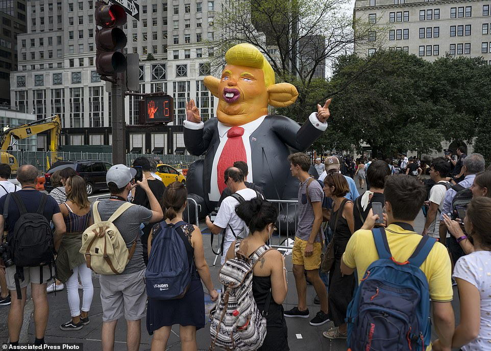 This parody inflatable was erected near the Plaza Hotel, two blocks up from Trump Tower itself. Crowds lined the streets in order to await Trump's return