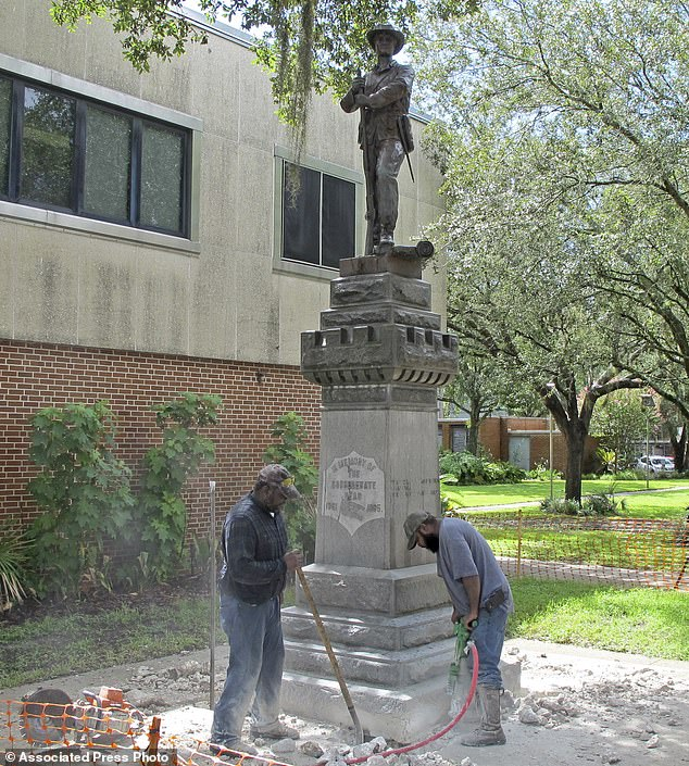 Workers began removing a Confederate statue in Gainesville, Florida on Monday. The statue is being returned to the local chapter of the United Daughters of the Confederacy, which erected the bronze statue in 1904