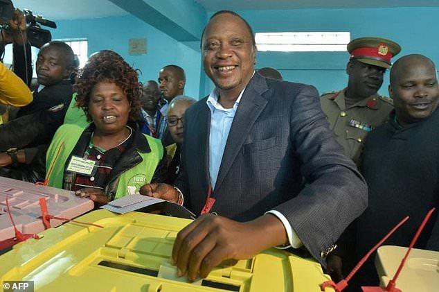 Kenya's incumbent President Uhuru Kenyatta votes at a polling station during the presidential election in Gatundu, Kiambu county August 8, 2017