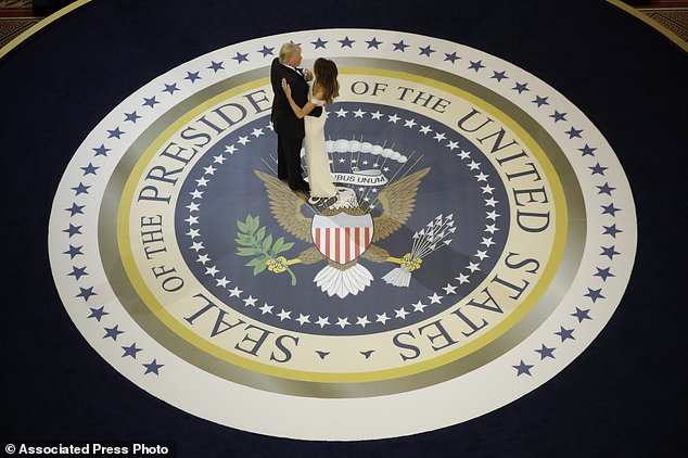 President Donald Trump dances with first lady Melania Trump, at The Salute To Our Armed Services Inaugural Ball in Washington