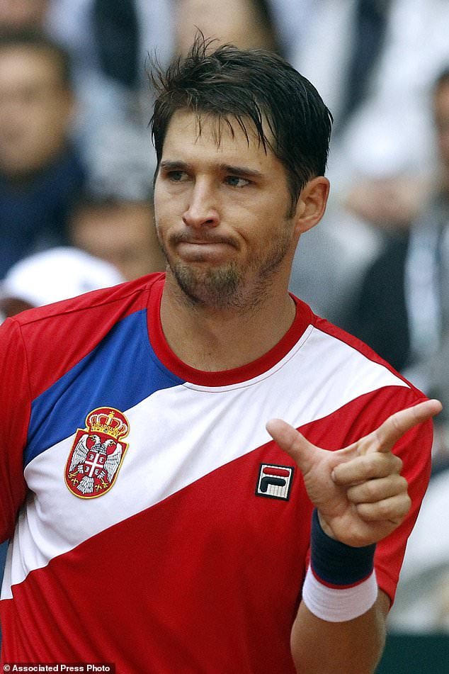Dusan Lajovic of Serbia gestures to Wilfried Tsonga of France during their Davis Cup semifinal at the Pierre Mauroy stadium in Lille, northern France, Sunday, Sept. 17, 2017. (AP Photo/Michel Spingler)