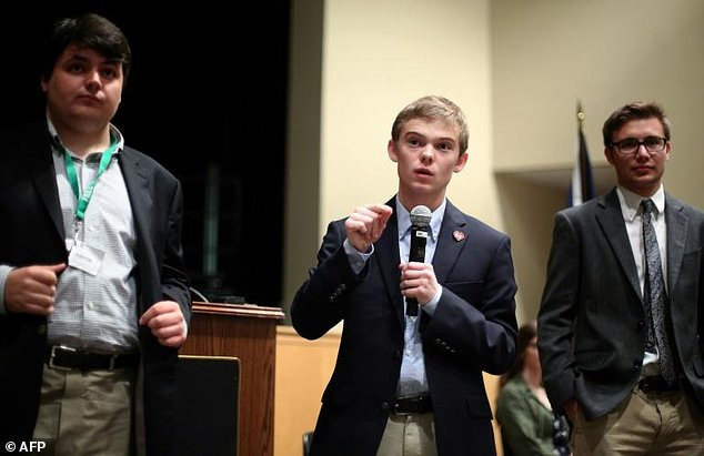 17-year-old Kansas governor candidate Tyler Ruzich speaks at a high school with three other teenage hopefuls for the state's top elected position