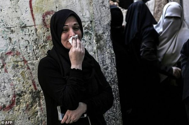 Relatives mourn in Khan Yunis, in the southern Gaza Strip, on October 31, 2017, during the funeral of Palestinians who were killed the previous day in an Israeli operation to blow up a tunnel stretching from the Gaza Strip into Israel