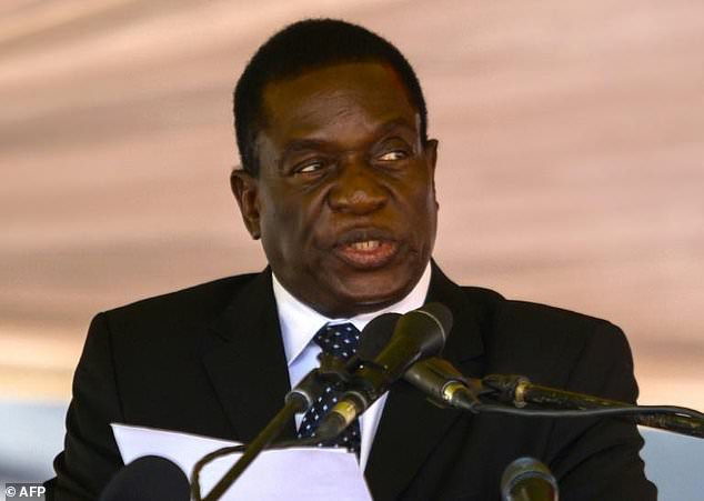 This file photo taken on January 7, 2017 shows Zimbabwe politician Emmerson Mnangagwa speaking during the funeral ceremony of Peter Chanetsa at the National Heroes Acre in Harare