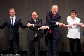 Image result for pics of weird handshakes in asia pacifi meetings\