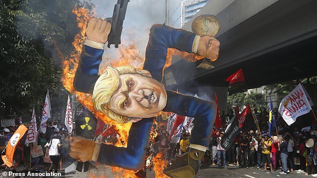 Image result for Protesters burn Donald Trump effigy in the Philippines, photos