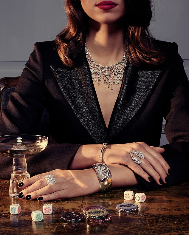 From top: snowflake diamond and akoya pearl necklace, £150,000, Birks. 18-carat rose gold and diamond interlocking bracelet and 18-carat yellow-gold and diamond interlocking, £4,950 each, both Shaun Leane. 18-carat white gold and diamond ring, £26,000, Messika. 18-carat white gold and diamond bracelet, £25,500, Chanel. 18-carat white gold and diamond ring, £32,728, Fabergé, from Harrods. Blazer, £720, Bella Freud. Champagne glass, £75, Lee Broom. Poker chips, price on application, Geoffrey Parker. Dice, £5, Aspinal of London