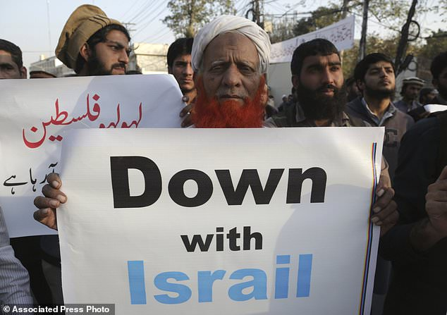Supporters of a Pakistani religious party rally against the United States and Israel, in Lahore, Pakistan, Thursday, Dec. 7, 2017. Hundreds of Islamists have rallied in major cities of Pakistan, condemning U.S. President Donald Trump for declaring Jerusalem as Israel's capital. (AP Photo/K.M. Chaudary)