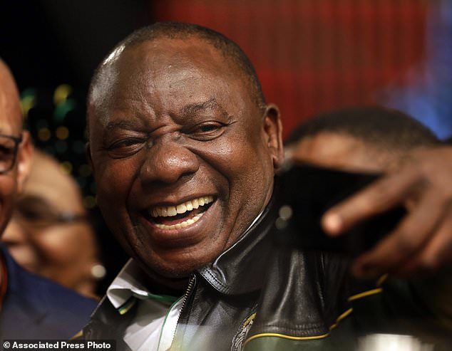 FILE  - In this Wednesday, July 5, 2017 file photo South Africa's deputy president Cyril Ramaphosa, takes a selfie at the end of the ANC's policy conference in Johannesburg, South Africa. As the African National Congress meets this weekend to choose a successor to scandal-ridden President Jacob Zuma, the race between his deputy and ex-wife, Dlamini-Zuma threatens to split Nelson Mandela's legacy. (AP Photo/Themba Hadebe. File)