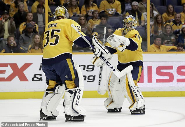 Nashville Predators goalie Pekka Rinne (35), of Finland, is replaced by Juuse Saros (74), of Finland, after Rinne gave up four goals against the Carolina Hurricanes during the first period of an NHL hockey game Thursday, Dec. 21, 2017, in Nashville, Tenn. (AP Photo/Mark Humphrey)