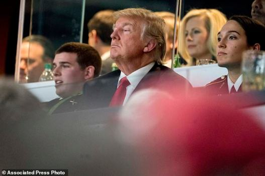 President Donald Trump watches the NCAA National Championship game at Mercedes-Benz Stadium, Monday, Jan. 8, 2018, in Atlanta, between Alabama and Georgia. (AP Photo/Andrew Harnik)