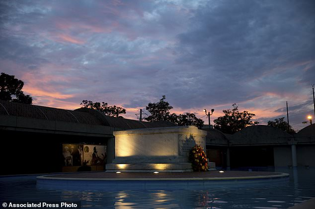FILE- In this Monday, Jan. 16, 2017, file photo, the tomb of Martin Luther King Jr., and his wife Coretta Scott King is seen as the sun sets, in Atlanta. The site is among about 130 locations in 14 states being promoted as part of the new U.S. Civil Rights Trail, which organizers hope will boost tourism in the region. (AP Photo/Branden Camp, File)