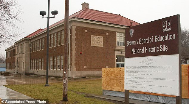 FILE - This March 3, 2004 file photo shows the Brown v. Board of Education National Historic Site as work continues in Topeka, Kansas. The site is among about 130 locations in 14 states being promoted as part of the new U.S. Civil Rights Trail, which organizers hope will boost tourism in the region. (AP Photo/Orlin Wagner, File)