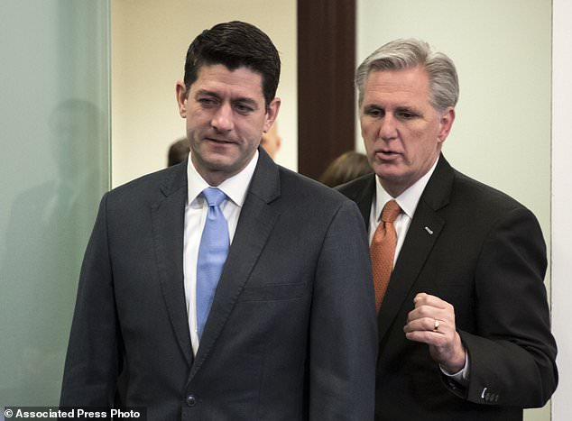 Speaker of the House Paul Ryan, R-Wis., left, and Majority Leader Kevin McCarthy, R-Calif., confer as they arrive to meet with reporters following a closed-door GOP strategy session at the Capitol in Washington, Tuesday, Feb. 6, 2018. The GOP-controlled House is slated Tuesday to pass a plan to keep the government open for six more weeks while Washington grapples with a potential follow-up budget pact and, perhaps, immigration legislation
