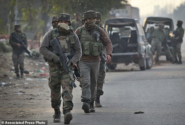 Indian Army soldiers arrive to take position at the Sunjwan Army camp in Jammu, India, Saturday, Feb. 10, 2018. A group of militants in Indian Kashmir opened fire Saturday inside an army camp in the disputed region, police said. The attack began early in the morning and it was unclear how many gunmen were involved, (AP Photo/Channi Anand)