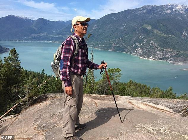 This handout photograph released on February 11, 2018 by the family of Iranian-Canadian environmentalist Kavous Seyed Emami shows him at an unidentified location
