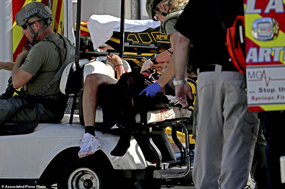 Medical personnel tend to a victim following a shooting at Marjory Stoneman Douglas High School in Parkland, Fla., on Wednesday, Feb. 14, 2018