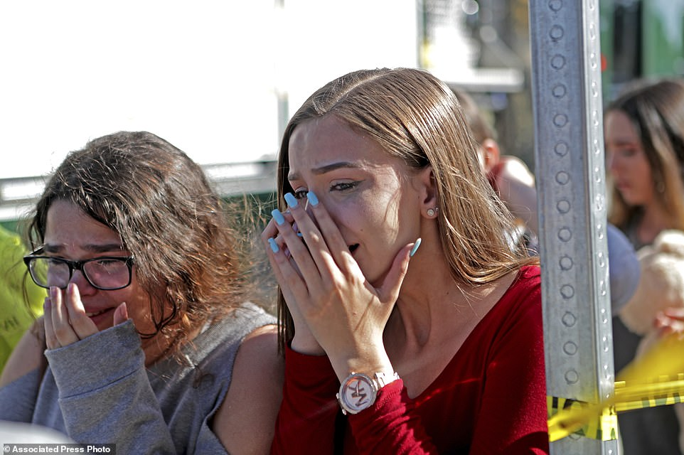 Students released from a lockdown are overcome with emotion following following a shooting at Marjory Stoneman Douglas High School in Parkland, Fla., Wednesday, Feb. 14, 2018