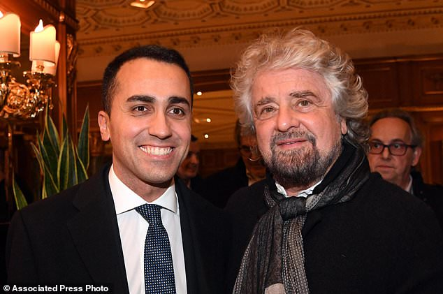 Luigi Di Maio, the Italian 5-Star Movement's leader, poses with party founder Beppe Grillo, right, in Rome, Monday, March 5, 2018. With the anti-establishment 5-Stars the highest vote-getter of any single party, the results confirmed the defeat of the two main political forces that have dominated Italian politics for decades - Forza Italia and the center-left Democrats - and the surging of populist and right-wing, euroskeptic forces that have burst onto the European scene. (Alessandro Di Meo/ANSA via AP)ALESSANDRO DI MEO