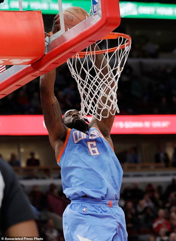 Los Angeles Clippers center DeAndre Jordan dunks against the Chicago Bulls during the first half of an NBA basketball game, Tuesday, March 13, 2018, in Chicago. (AP Photo/Nam Y. Huh)
