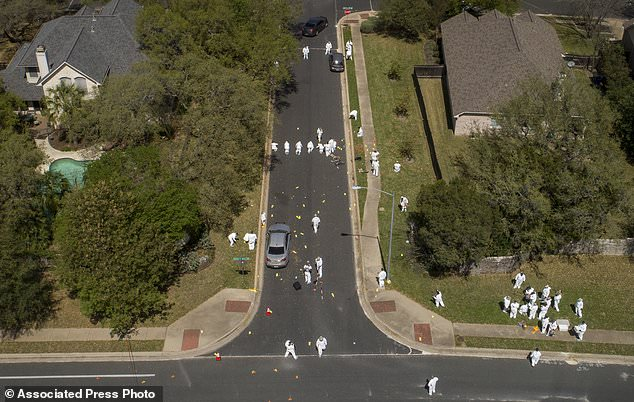 Investigators on Monday March 19, 2018, work at the scene of a bomb explosion on Dawn Song Drive in Austin, Texas, that seriously injured two men Sunday. Two people have now been killed and four wounded in bombings over a span of less than three weeks. ( Jay Janner/Austin American-Statesman via AP)