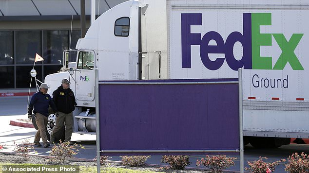 FBI agents investigate the scene at a FedEx distribution center where a package exploded, Tuesday, March 20, 2018, in Schertz, Texas. Authorities believe the package bomb is linked to the recent string of Austin bombings. (AP Photo/Eric Gay)