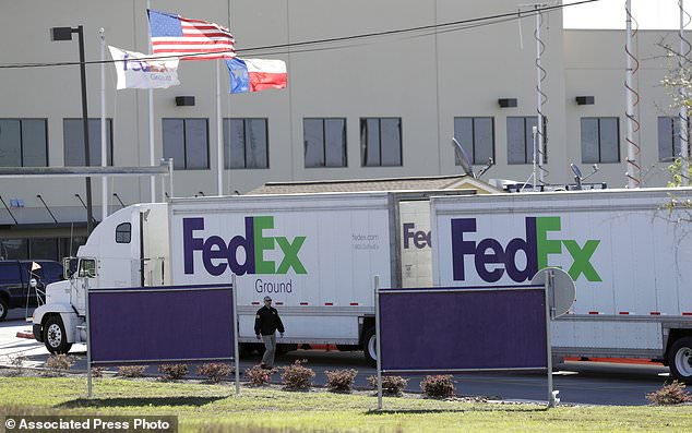 An FBI agent investigates at a FedEx distribution center where a package exploded, Tuesday, March 20, 2018, in Schertz, Texas. Authorities believe the package bomb is linked to the recent string of Austin bombings. (AP Photo/Eric Gay)