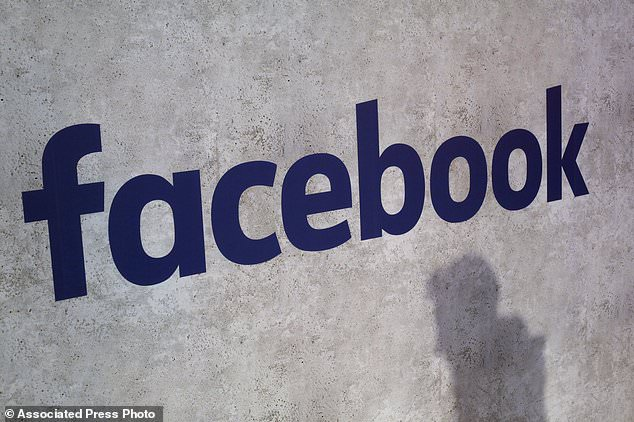 File - This Jan. 17, 2017, file photo shows a Facebook logo being displayed in a start-up companies gathering at Paris' Station F, in Paris.  Facebook is on the offensive to try to contain swirling concerns about how it protects the data of its 2.2 billion members. As CEO Mark Zuckerberg prepares to face Congress on Tuesday, April 10, 2018,  and the company rolls out new privacy rules, the social media juggernaut is facing the most serious challenge in its 14-year-history and seeking to maintain people's trust and avoid a user exodus.(AP Photo/Thibault Camus, File)