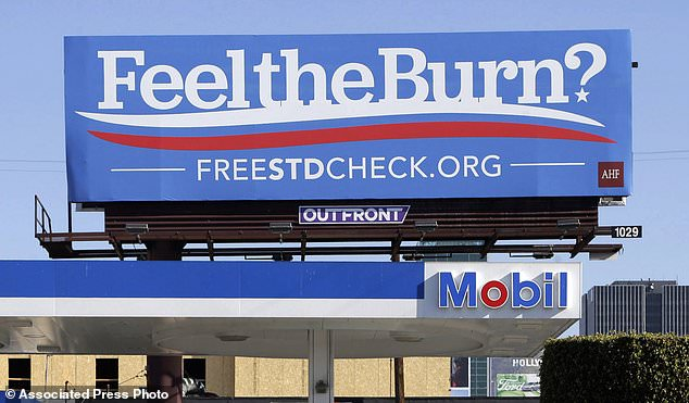 A Billboard advertises free STD tests using a play on former former presidential candidate Bernie Sanders's campaign slogan. Rates of STDs have shot up 45 percent in California (file)