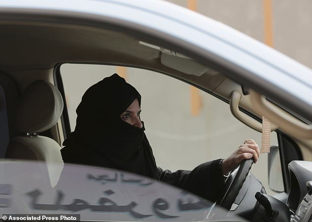 In this March 29 photo, Aziza al-Yousef drives a car on a highway in Riyadh, Saudi Arabia, as part of a campaign to defy Saudi Arabia's ban on women driving. Aziza is also said to have been arrested. She is a retired professor at King Saud University, a mother of five and a grandmother of eight