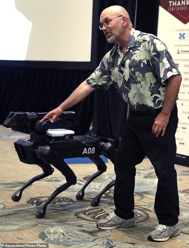 Boston Dynamics founder Marc Raibert (pictured with his creation SpotMini) doesn't rule out future military applications for his terrifying machines. But he has played down fears that his company's robots could one day be used to kill