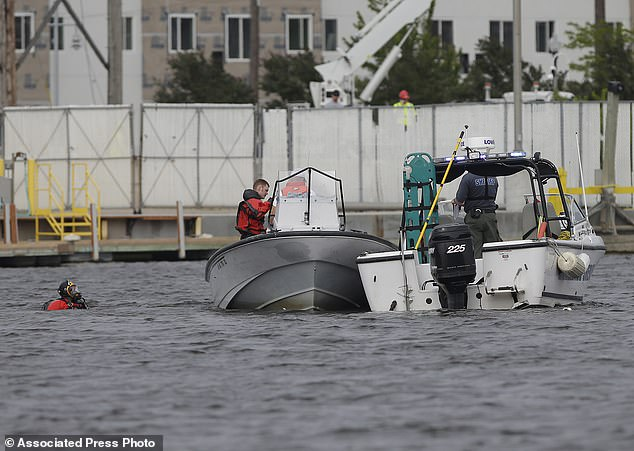 Winnebago County Sheriff's dive team searched the Fox River in Oshkosh Wisconsin to recover the wreckage and the body