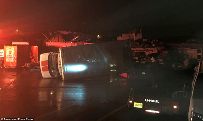 Right after the storm: Wilkes-Barre was wrecked in a severe storm Wednesday evening destroying stores and flipping cars