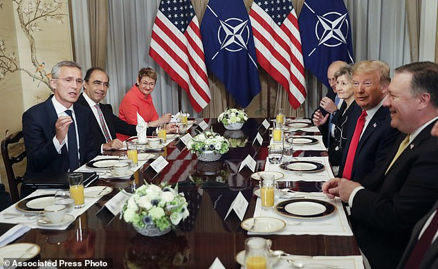 U.S. President Donald Trump, second right, listens to NATO Secretary General Jens Stoltenberg, left, during their bilateral breakfast, Wednesday July 11, 2018 in Brussels, Belgium. (AP Photo/Pablo Martinez Monsivais)