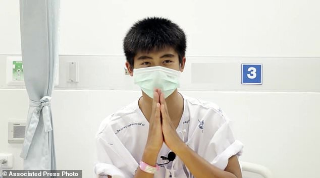 This picture from a July 13, 2018 video released by Chiang Rai Prachanukroh Hospital shows Pipat Bodhi, one of 12 boys rescued from the flooded cave, in her hospital room at the Chiang Rai Prachanukroh Hospital in Chiang Rai Province Thailand. The video was shown during a press conference on Saturday, July 14, 2018 in the hospital. (Chiang Rai Prachanukroh Hospital via AP)