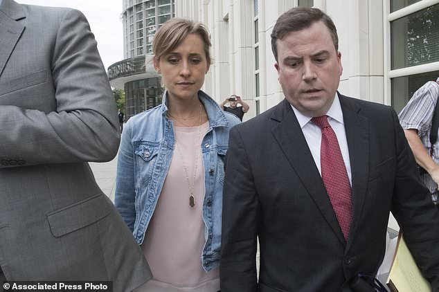 Raniere and Allison Mack (above leaving court last month) are accused of coercingNxivm followers into becoming slaves to senior members