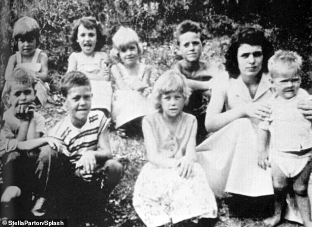Stella (back row, third from left) with family and sister Dolly (front row, third from left) in 1954