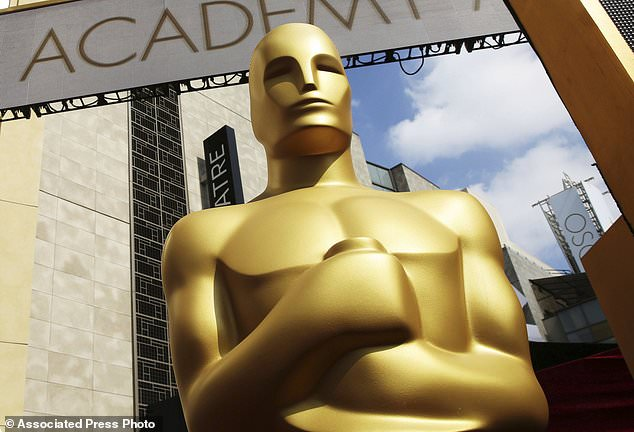 The Oscars are adding a new category to honor popular films and promising a brisk 3-hour ceremony on a much earlier air date