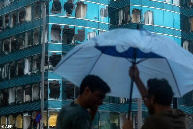 The storm, with gusts of more than 230kph (142 mph), sent buildings swaying in Hong Kong and smashed windows in tower blocks and skyscrapers as people cowered inside