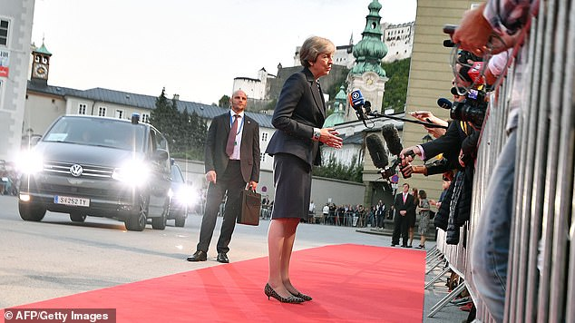 The Prime Minister stuck to her line that Europe must evolve its position as Britain has done to reach a compromise deal as she addressed reporters tonight (pictured)