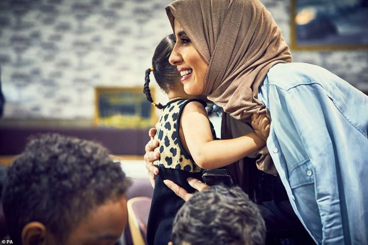 Halima Al-huthaifi hugs a girl at the Hubb Community Kitchen in West London in the aftermath of the Grenfell Tower fire